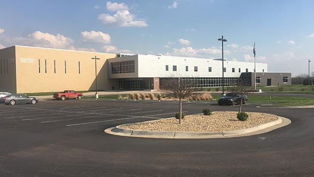 SBB Engineering Seaman Bond Project completed exterior with parking lot of Seaman Middle School image